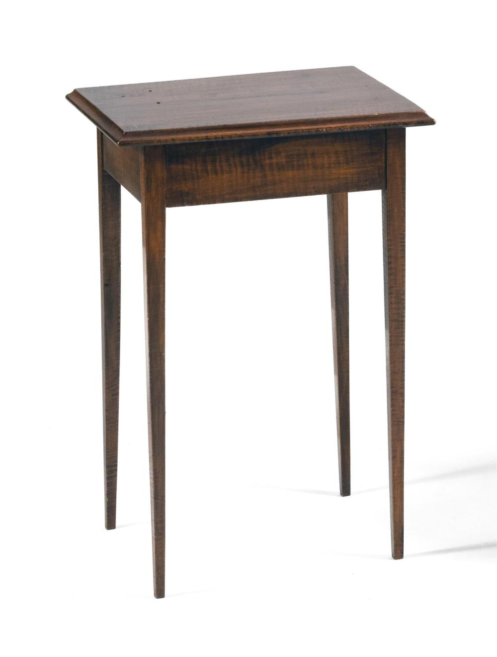 """COUNTRY HEPPLEWHITE STAND In curly maple, with a molded-edge top and slender tapered legs. Height 28.25"""". Top 16"""" x 18.5""""."""