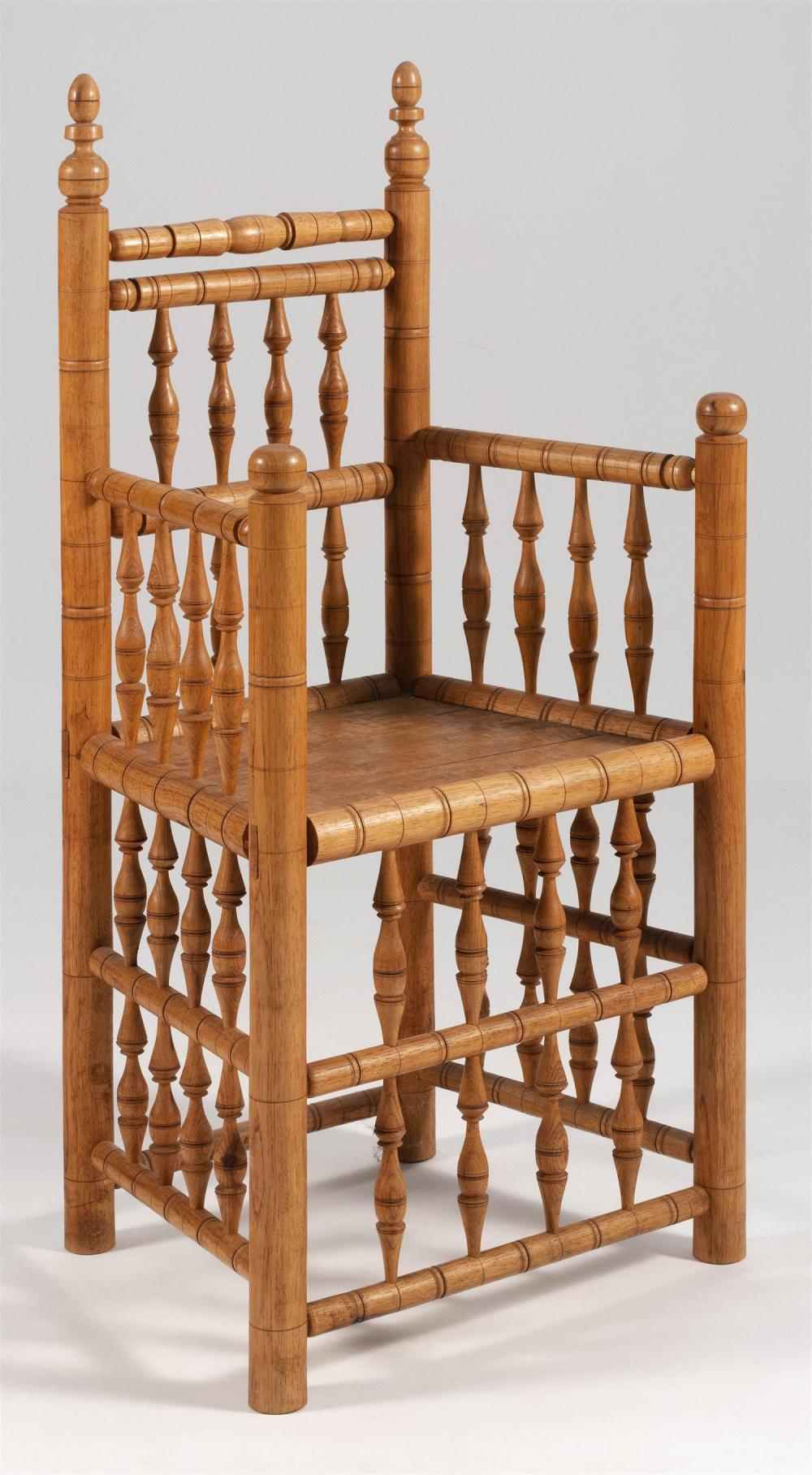 "PILGRIM-STYLE HARDWOOD ARMCHAIR Made by Heart of the Wood. Back height 48.25"". Seat height 21.5""."