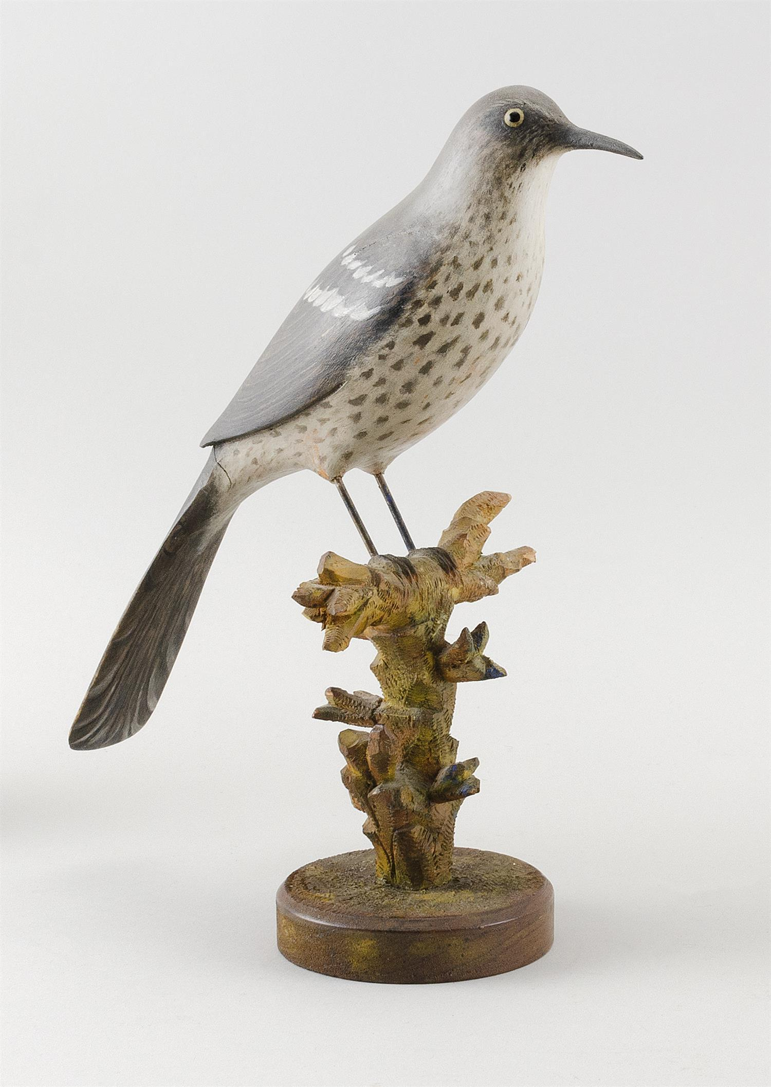 EXCEPTIONAL LIFE-SIZE BROWN THRASHER Mounted with wire legs on a carved wooden base simulating a branch. Marked on underside of base...