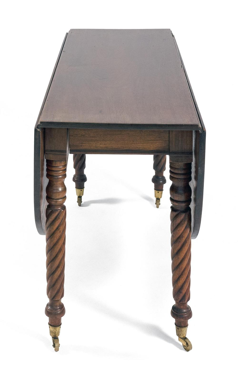 SHERATON DROP-LEAF TABLE In mahogany, with demilune drop leaves and bold rope-turned legs fitted with brass casters. Height 28.75