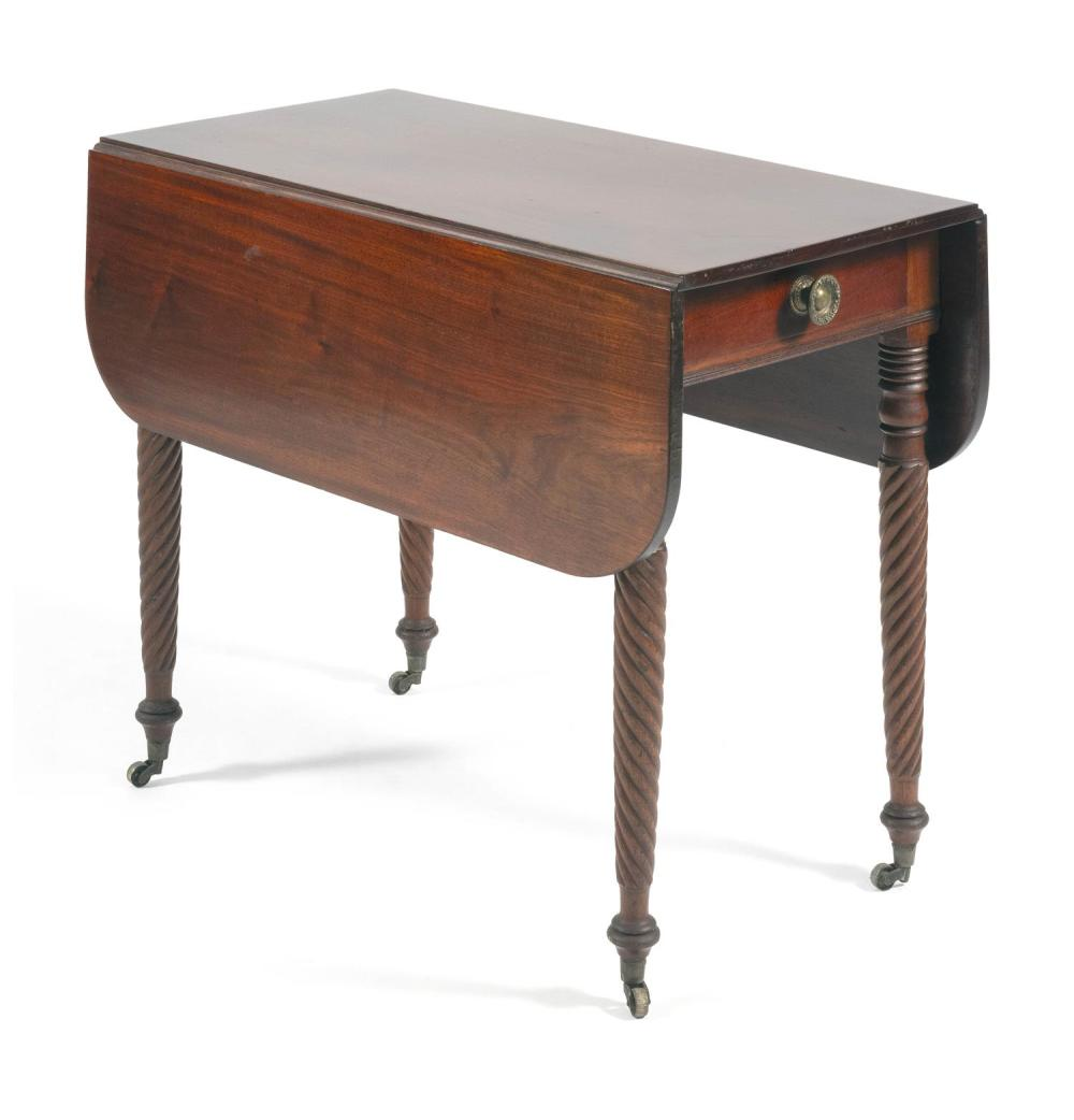 SHERATON DROP-LEAF TABLE In mahogany. Leaves with cut corners. Single drawer at one end of apron. Rope-turned legs fitted with brass...