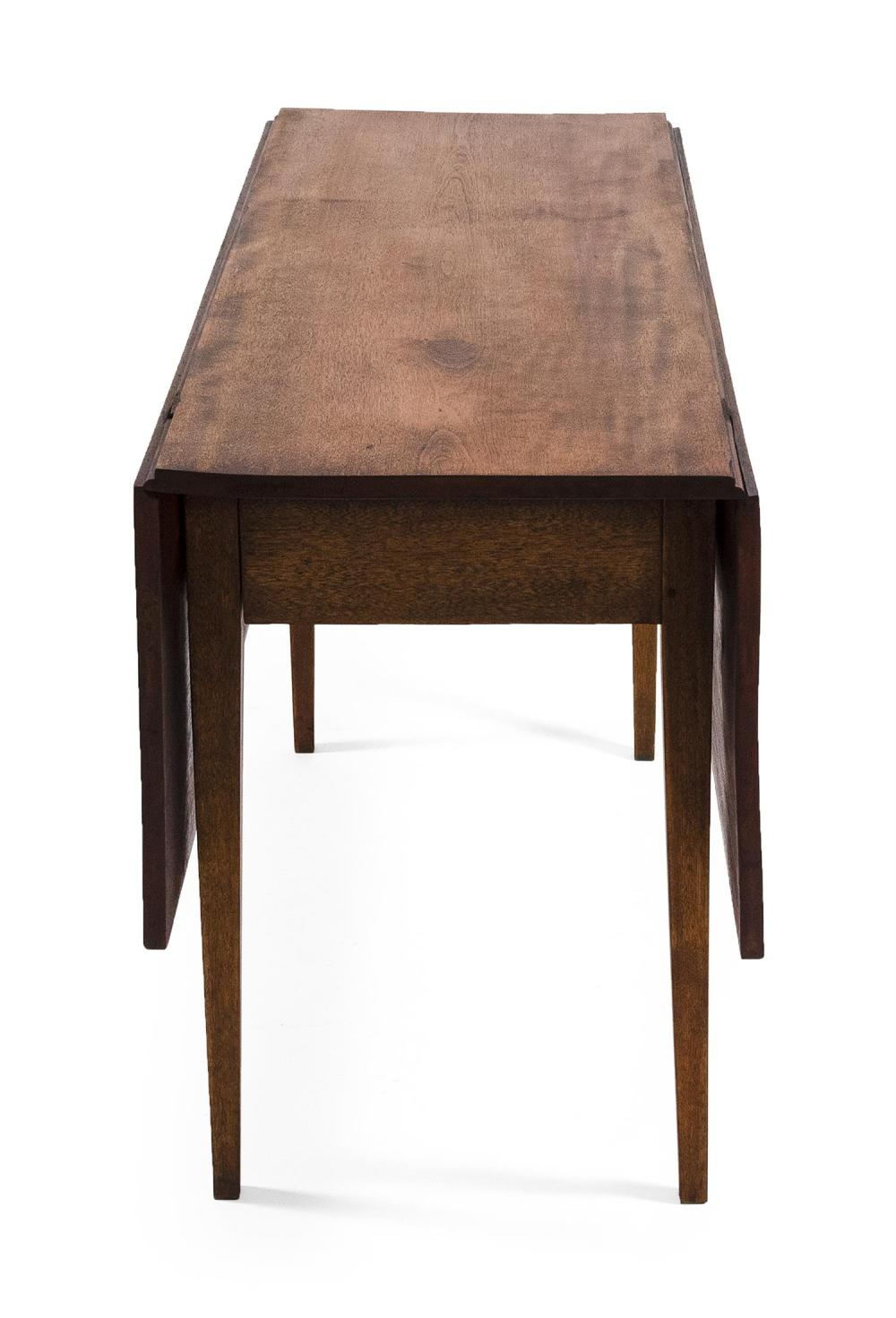 HEPPLEWHITE DROP-LEAF TABLE In mahogany, with tapered legs. Height 28