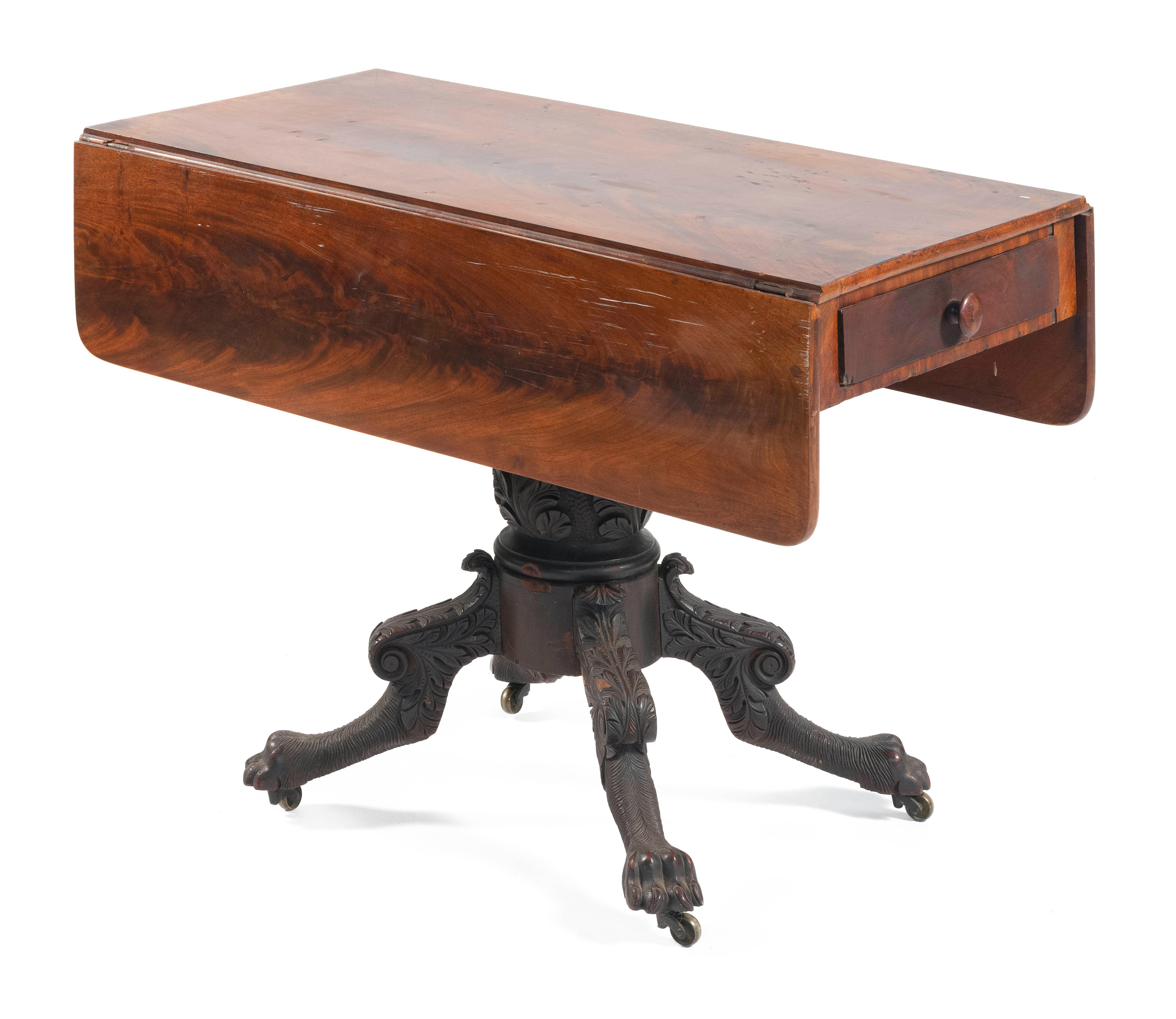 FEDERAL DROP-LEAF TABLE In mahogany and mahogany veneer. Top and leaves in select flame mahogany. Single drawer in apron. Acanthus-c...