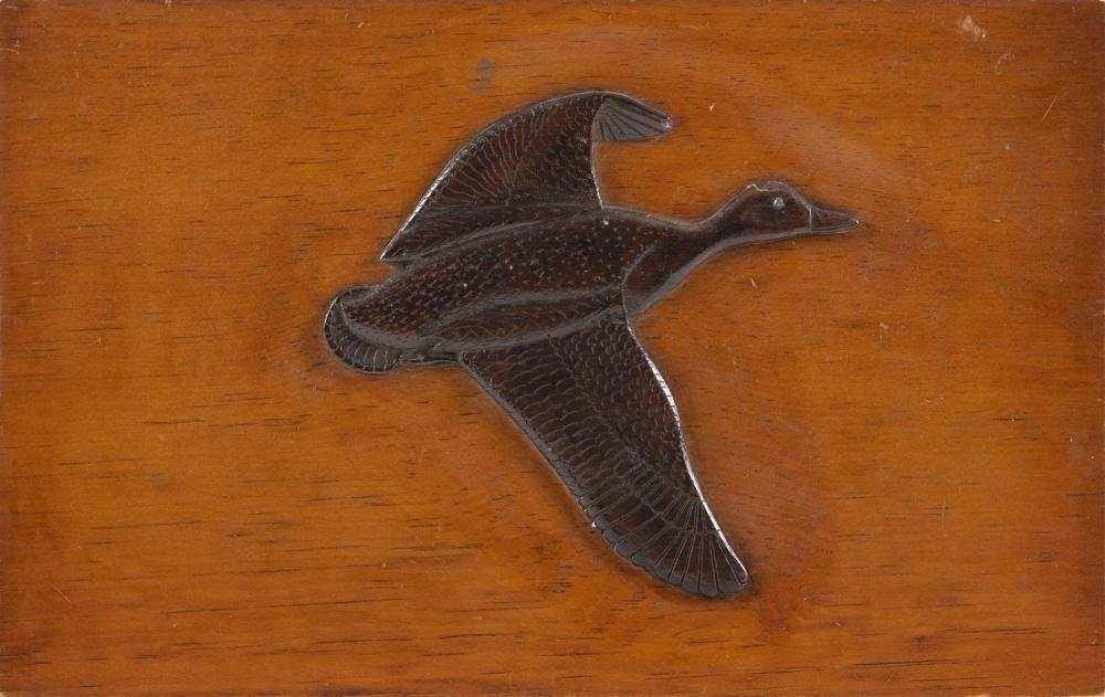 CHARLES HART RELIEF-CARVED FLYING BLACK DUCK PLAQUE Duck under a dark brown stain on a lighter stained plaque. Signed in pencil vers...