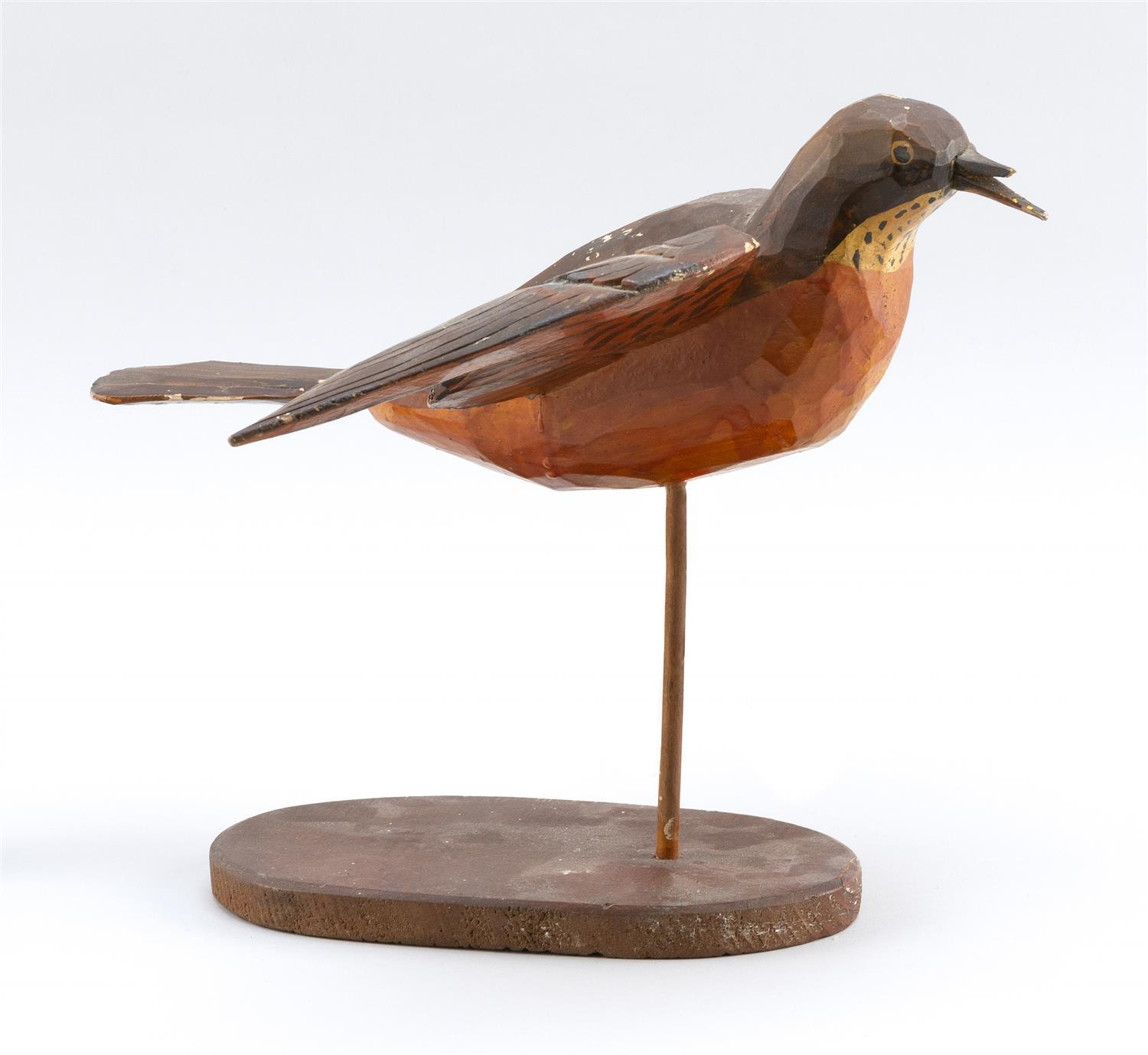 """FOLK ART LIFE-SIZE CARVING OF A ROBIN Painted eyes. Carved outstretched wings. Length 13"""". Wingspan 14""""."""