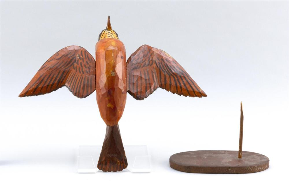 FOLK ART LIFE-SIZE CARVING OF A ROBIN Painted eyes. Carved outstretched wings. Length 13