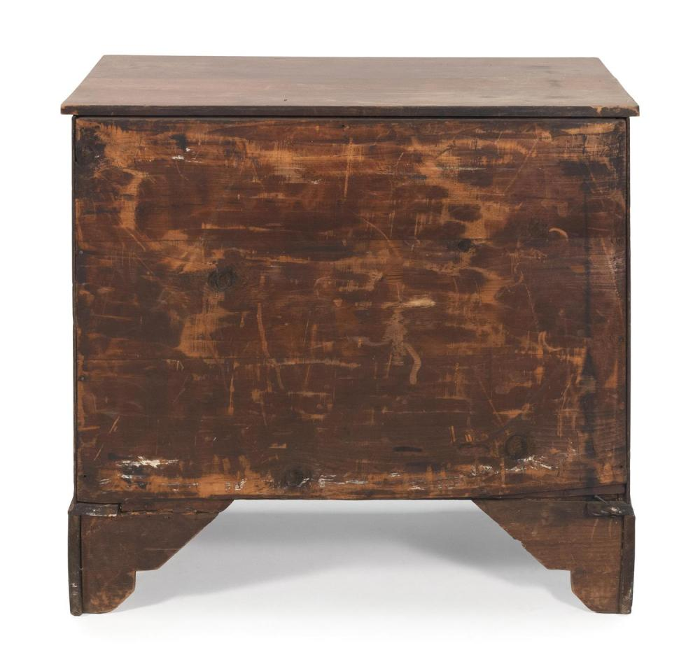 CHIPPENDALE FOUR-DRAWER CHEST In mahogany and mahogany veneer. Four full-width graduated drawers with oval brass bail pulls. High fl...