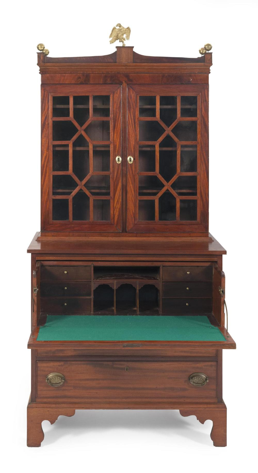 FEDERAL TWO-PART SECRETARY In mahogany and mahogany veneer. Upper portion with shaped cornice and two glazed doors enclosing three i...