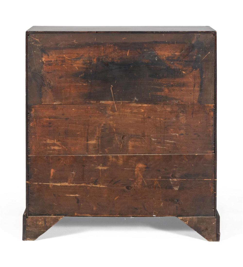 CHIPPENDALE SLANT-LID DESK In birch under a mahogany-colored stain. Slant lid encloses a fitted interior. Case with four graduated d...