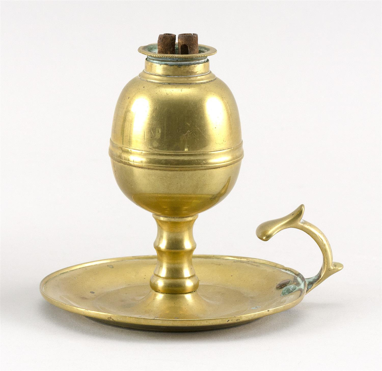 """BRASS WHALE OIL LAMP With screw-in burner and saucer base with thumb-grip handle. Height 4""""."""