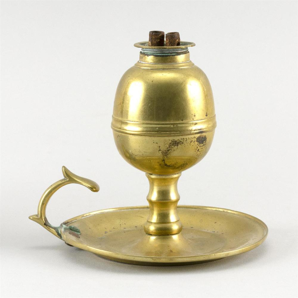 BRASS WHALE OIL LAMP With screw-in burner and saucer base with thumb-grip handle. Height 4