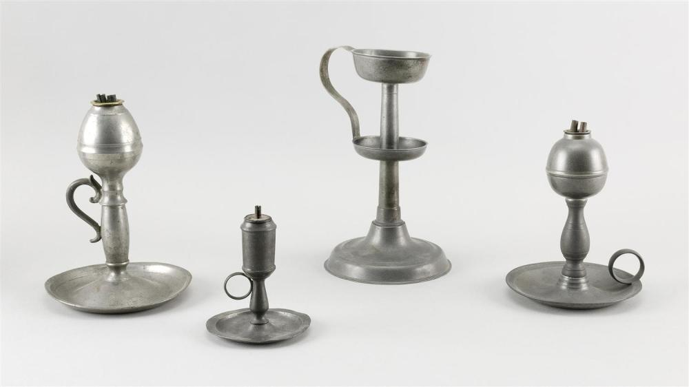"FOUR PEWTER CHAMBER STICK-STYLE WHALE OIL LAMPS Heights from 4.5"" to 8.5""."
