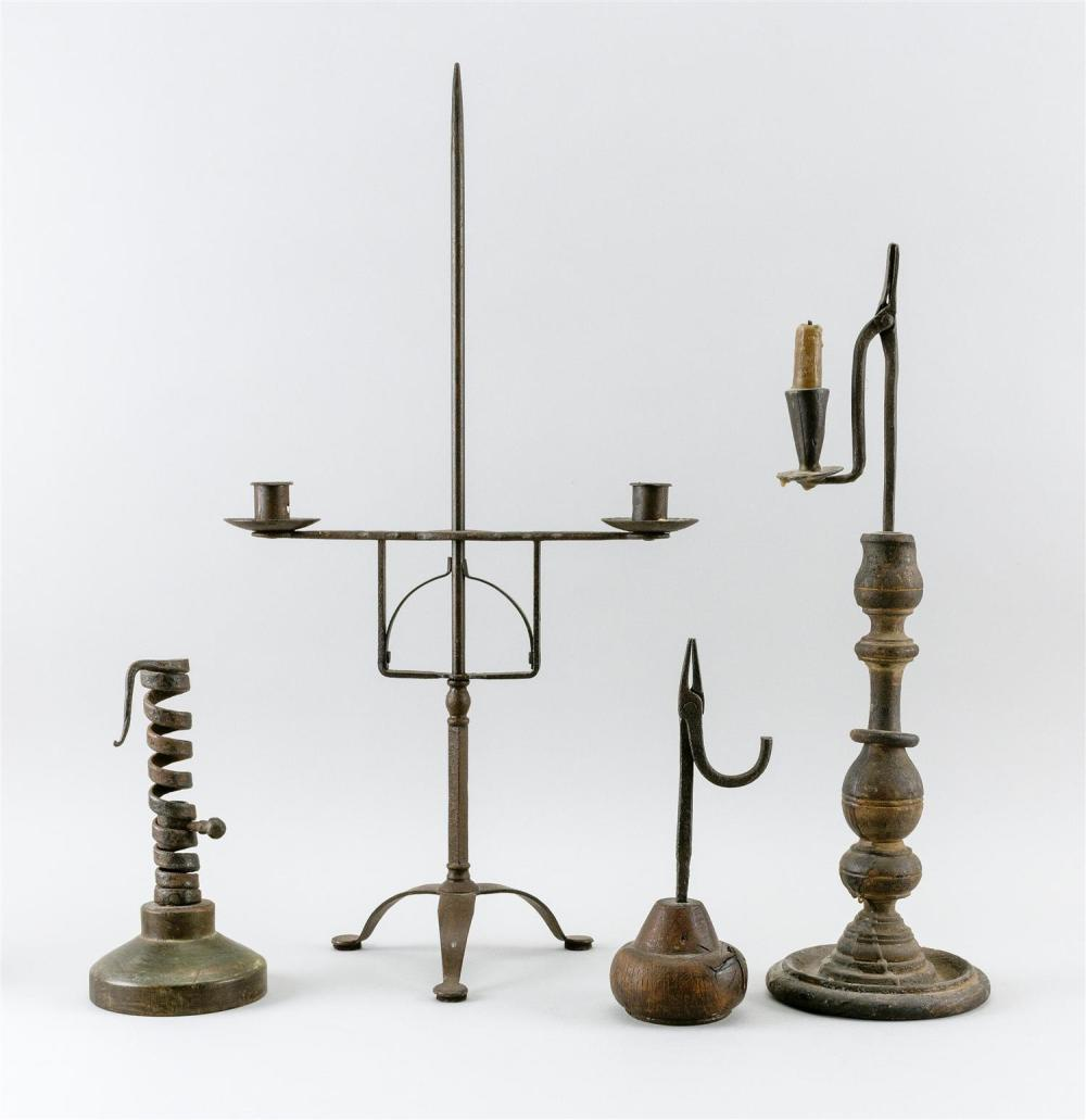 "FOUR EARLY WROUGHT IRON AND WOODEN LIGHTING DEVICES 1) Combination rush holder with a turned wooden base. Height 18.5"". 2) Rush hold..."
