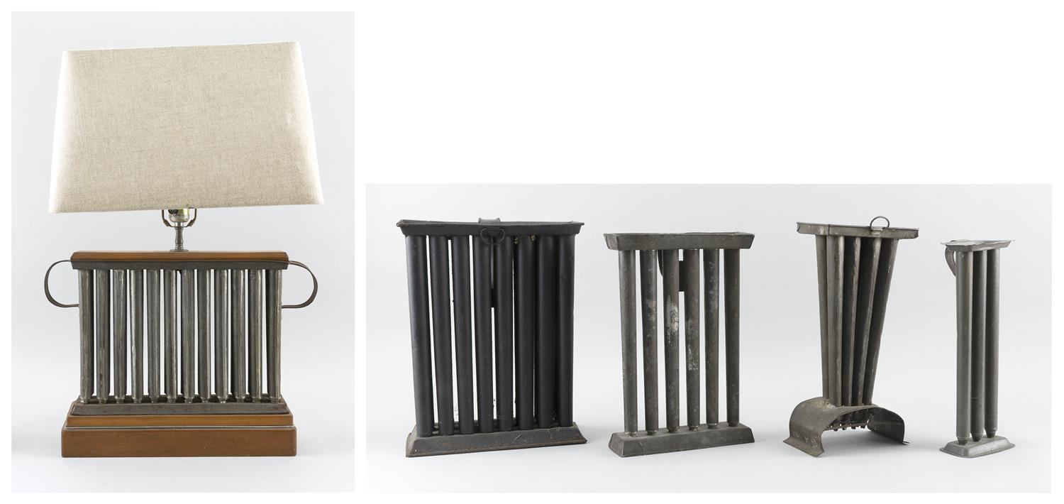 "FIVE ASSORTED TIN CANDLE MOLDS One mounted as a table lamp. Heights including lampshade from 10"" to 27""."