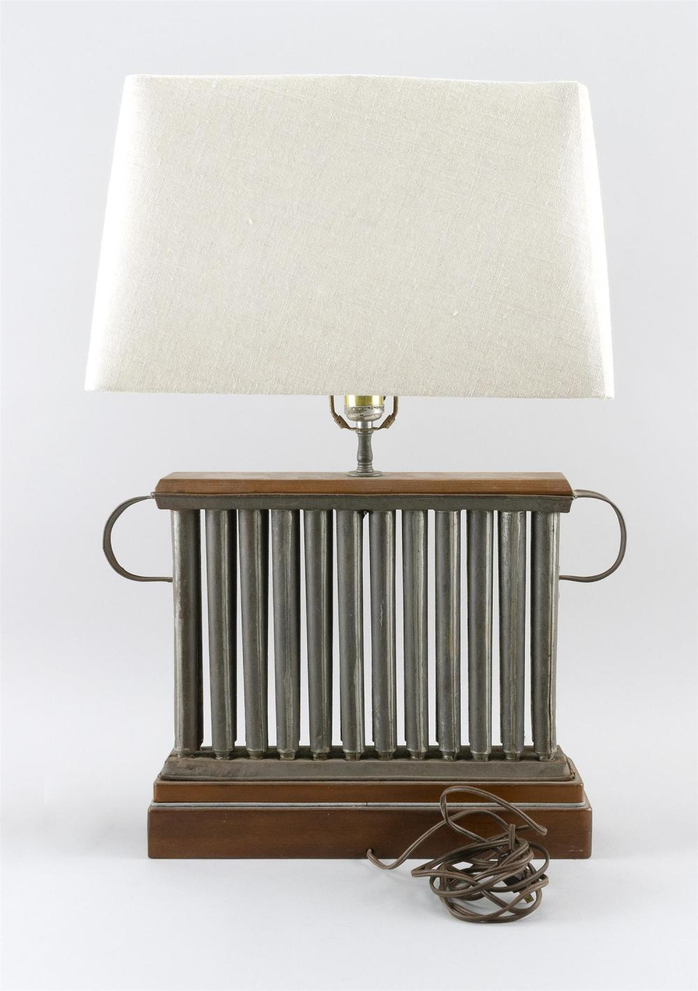 FIVE ASSORTED TIN CANDLE MOLDS One mounted as a table lamp. Heights including lampshade from 10