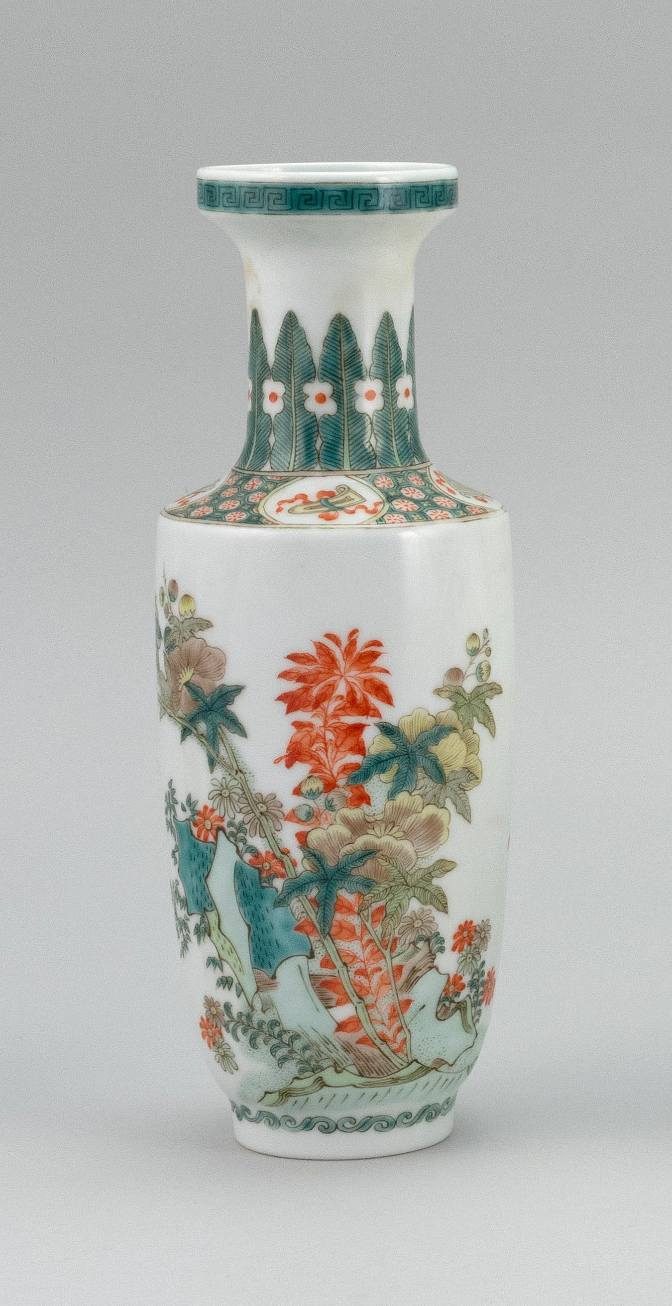 CHINESE FAMILLE VERTE PORCELAIN VASE In rouleau form, with finely detailed decoration of butterflies in a flowering landscape. Six-c...