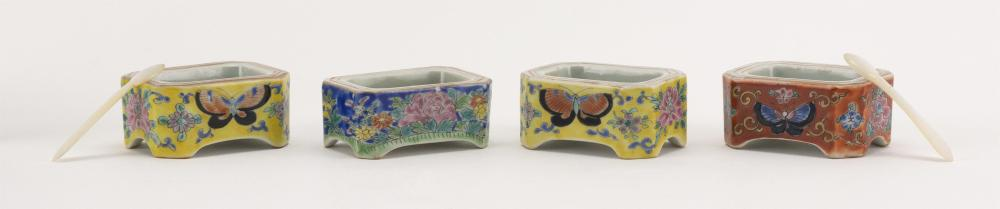 """FOUR CHINESE POLYCHROME PORCELAIN SALTS Butterfly and floral decoration in famille jaune, blue and red. Marked on bases. Lengths 2""""...."""