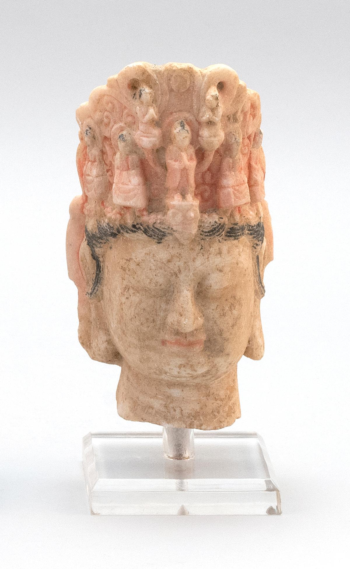 "CHINESE POLYCHROME MARBLE HEAD OF GUANYIN Wearing an elaborate headdress decorated with seven bodhisattvas. Height 7""."