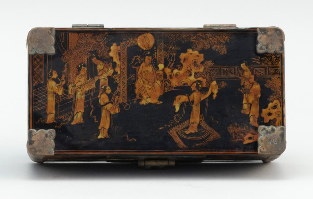 CHINESE BLACK AND GOLD LACQUER HINGED BOX Rectangular, with figural landscape design. Length 7.75