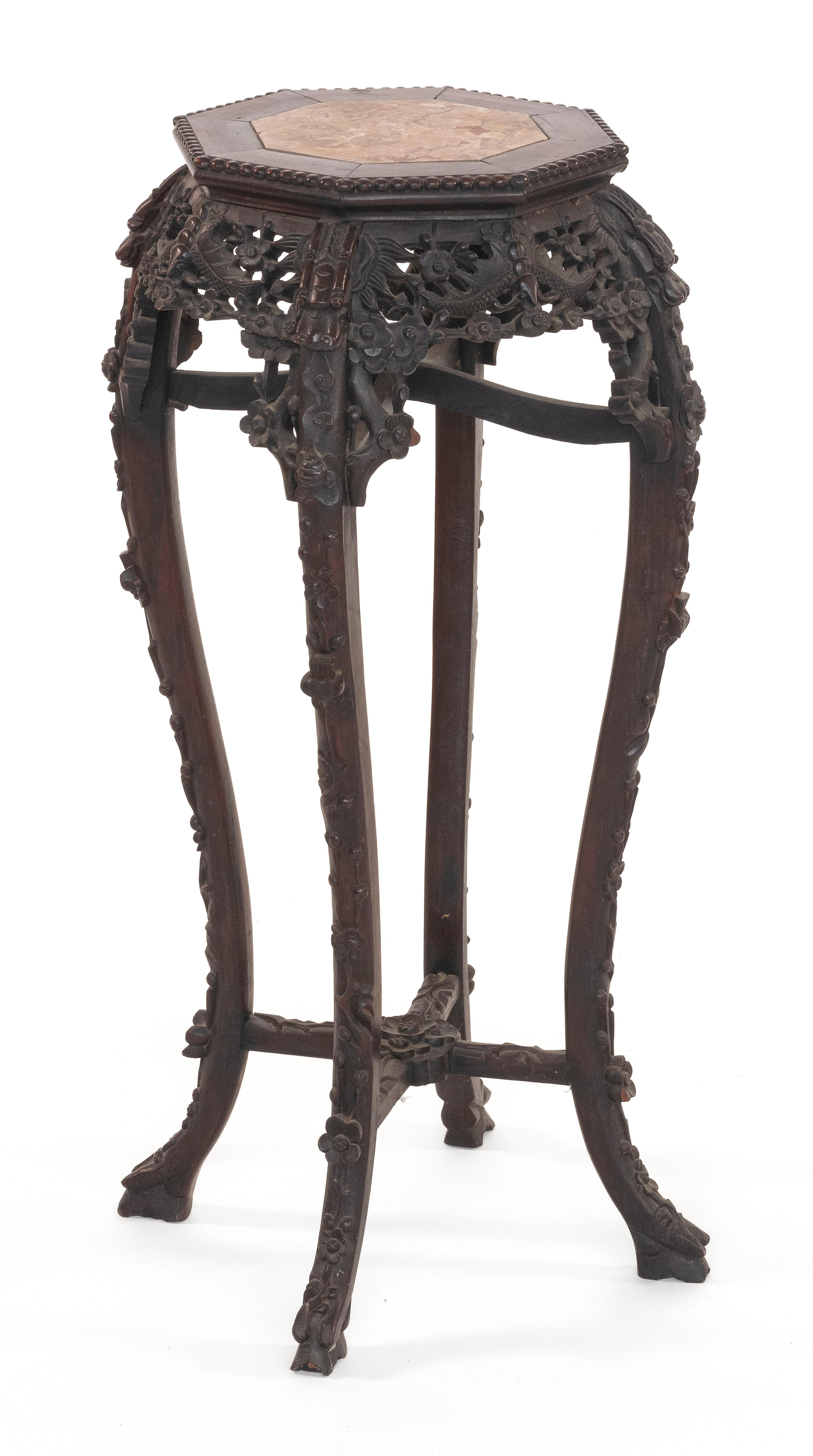 CHINESE FINELY CARVED WOOD TABORET Octagonal top inset with rouge marble. Apron with finely carved bats and cherry blossoms. Four cy...