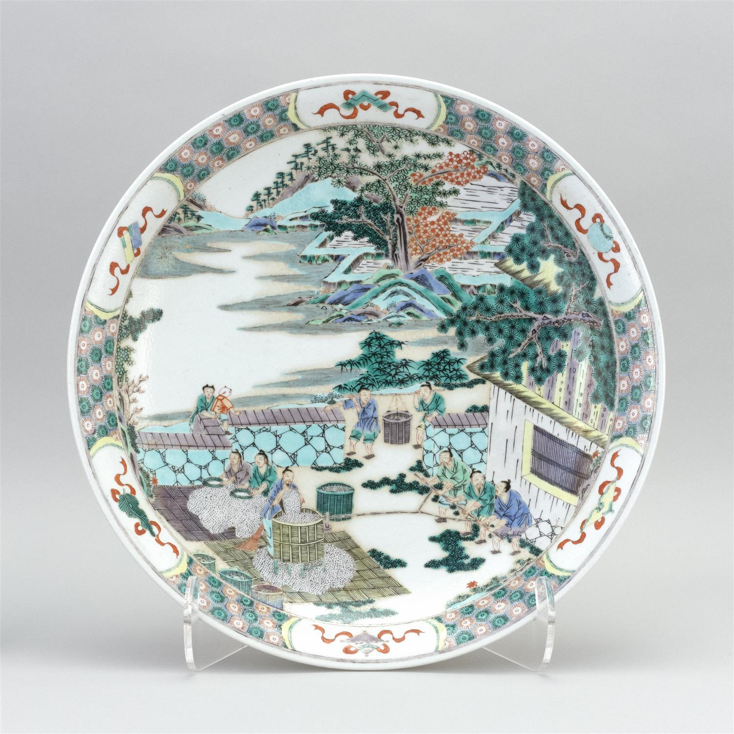 "CHINESE FAMILLE VERTE PORCELAIN CHARGER Figural landscape decoration. Six-character Kangxi mark on base. Diameter 16.6""."