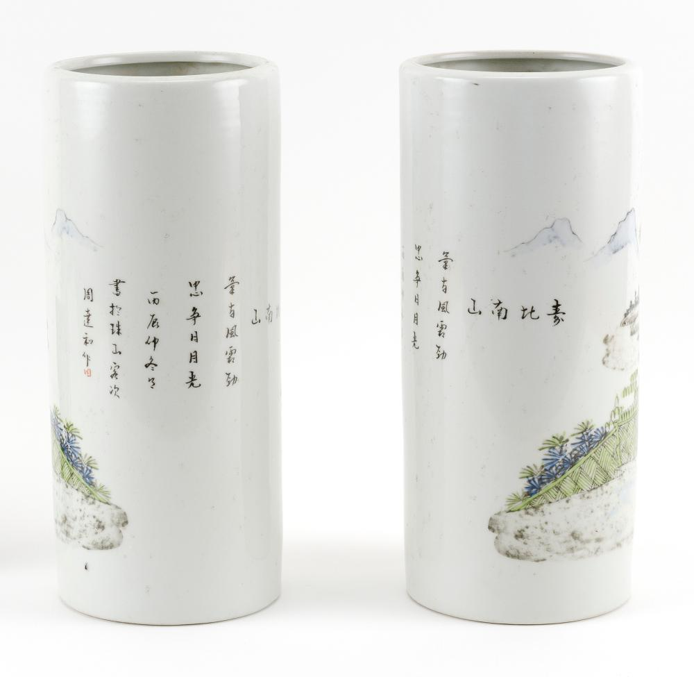 PAIR OF CHINESE PORCELAIN CYLINDRICAL VASES Decoration of a sage and a child. Heights 11.6