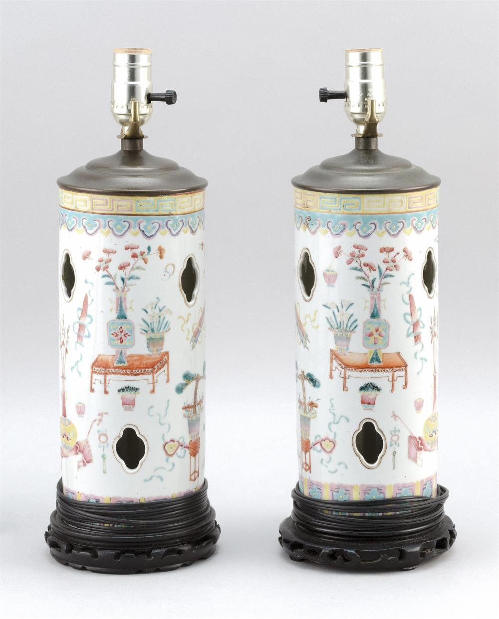 "PAIR OF CHINESE FAMILLE ROSE PORCELAIN HAT STANDS Decorated with scholar's objects, vases and jardinières. Heights 11"". Mounted as t.."
