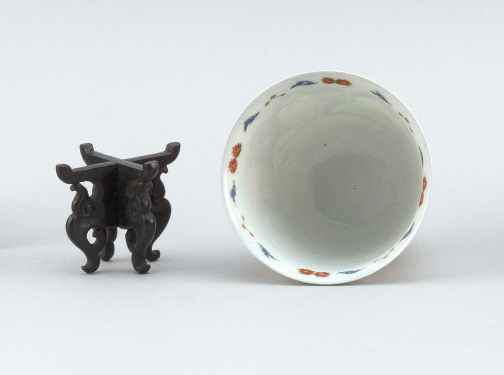 CHINESE POLYCHROME PORCELAIN CUP Exterior decorated with bird and floral cartouches connected with a brocade banner. Interior rim wi...