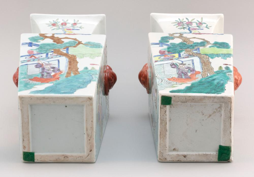 PAIR OF CHINESE FAMILLE ROSE PORCELAIN JARS Rectangular, with square mouths, flared necks and salmon red animal-head mock ring handl...