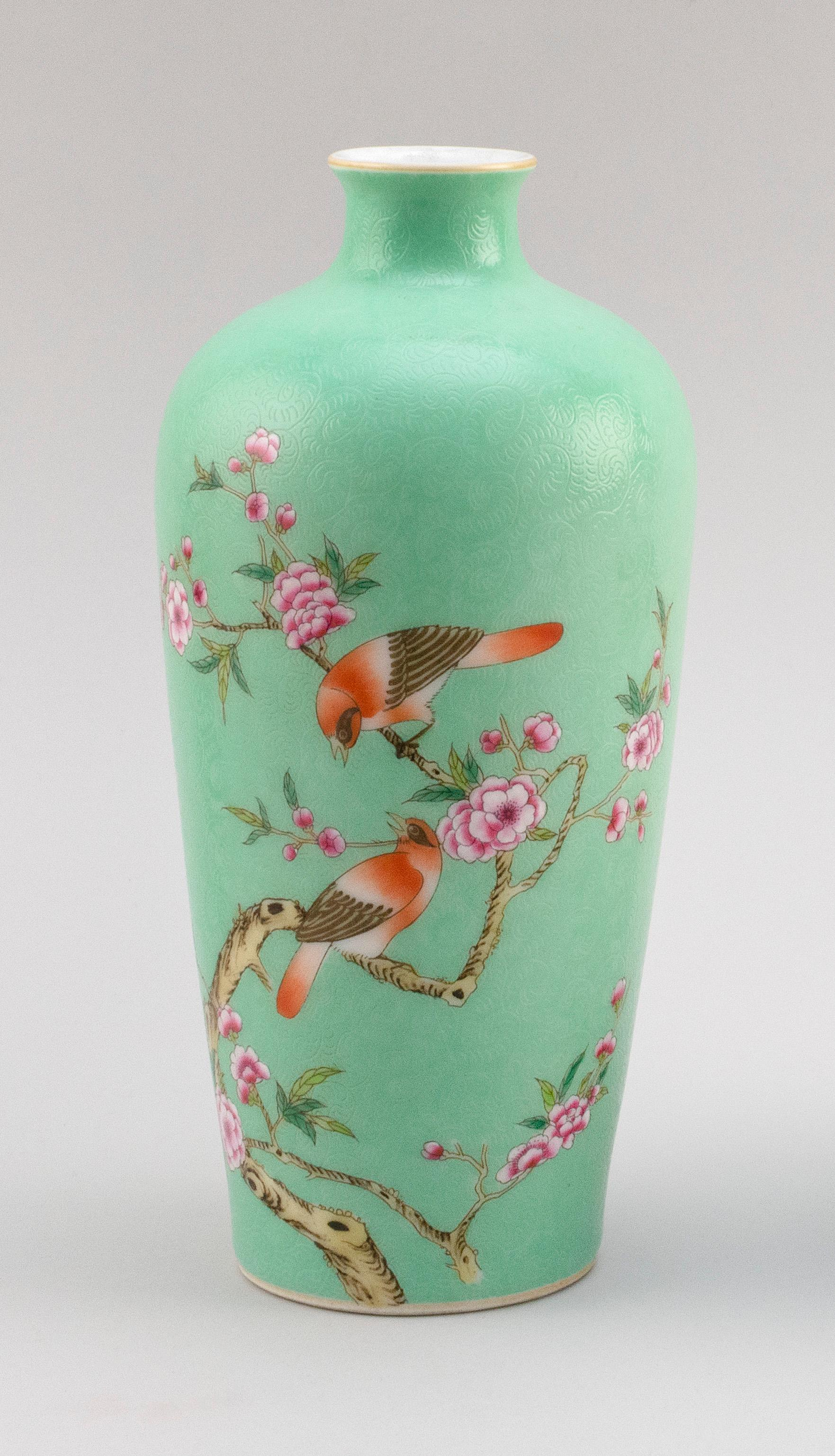 CHINESE FAMILLE ROSE PORCELAIN MEIPING VASE Decoration of two songbirds on a flowering tree branch on a celadon green ground with in...