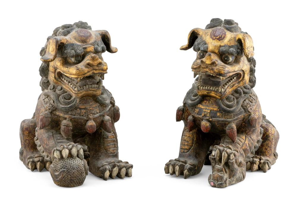 PAIR OF GILTWOOD FU DOG TEMPLE GUARDIAN FIGURES A male with brocade ball and a female with pup. Both with gilt faces and ears, and t...