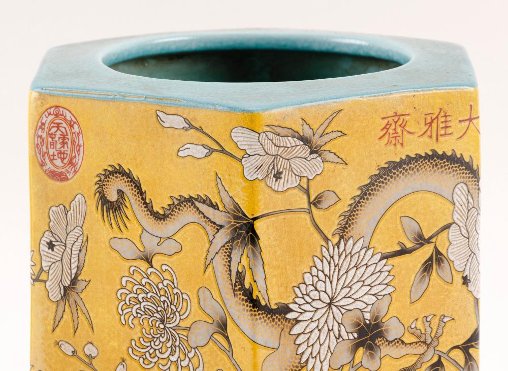 CHINESE PORCELAIN BRUSH POT Hexagonal, with dragon and flower decoration on a yellow ground. Dowager Empress seal at rim. Four-chara...