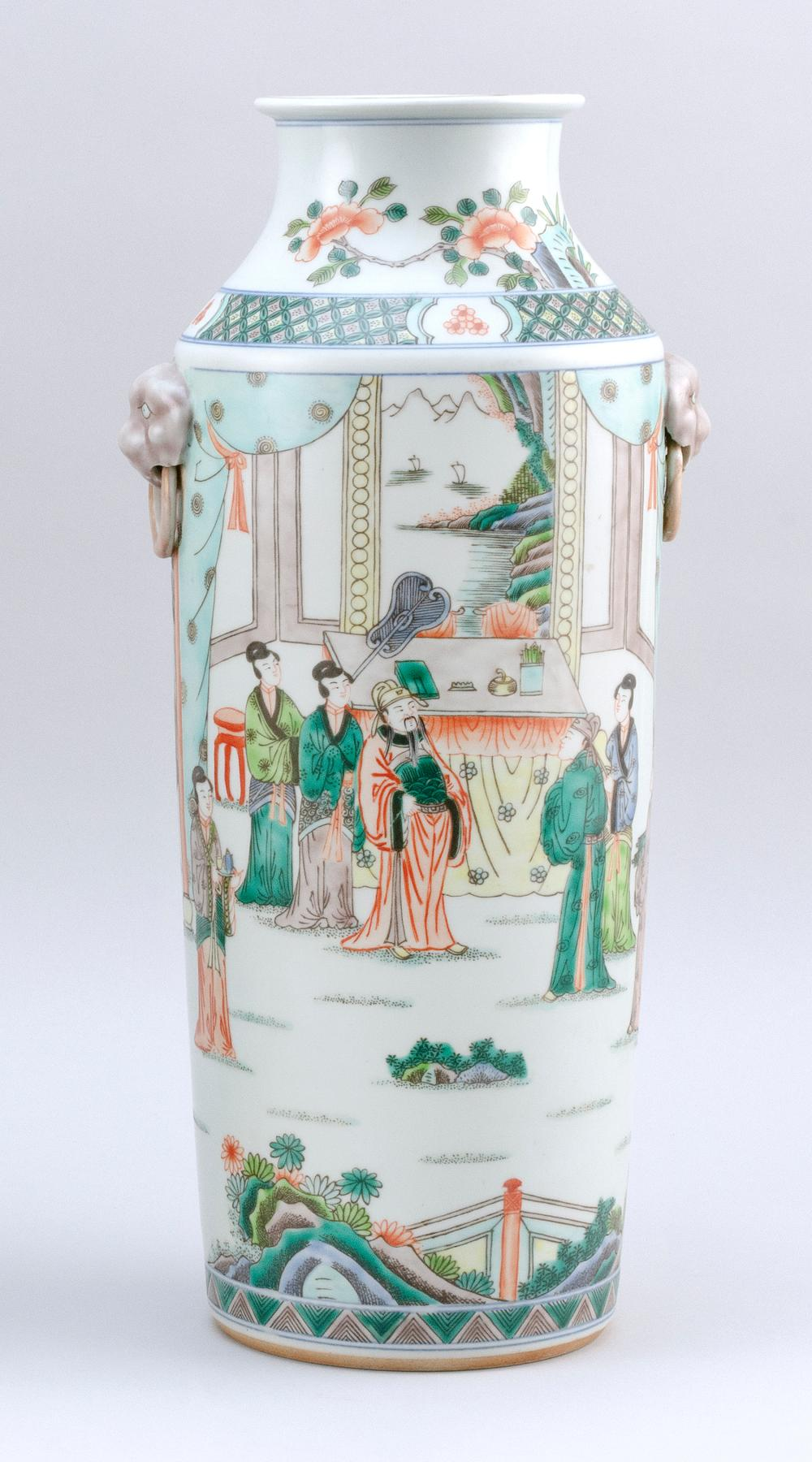 CHINESE FAMILLE VERTE PORCELAIN VASE Cylindrical, with two lion's-head mock ring handles and figural landscape decoration. Six-chara..