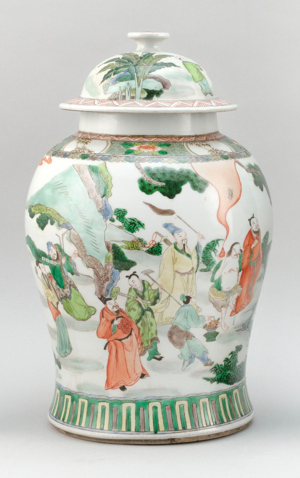 CHINESE FAMILLE VERTE PORCELAIN TEMPLE JAR In inverted pear shape, with domed cover and figural landscape decoration. Six-character...