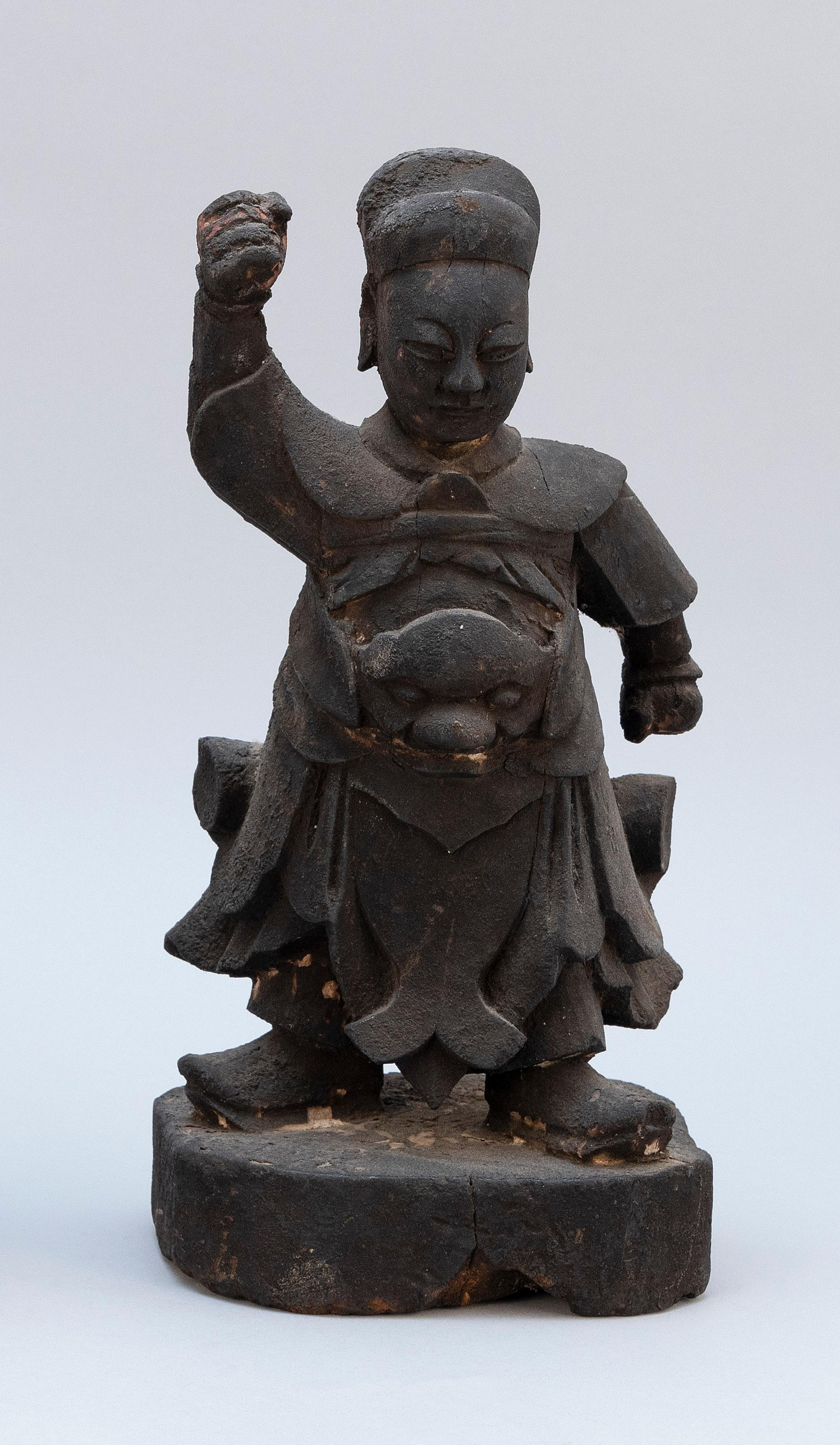 """CHINESE CARVED WOOD GUANDI Standing on a wood base. Height 12""""."""