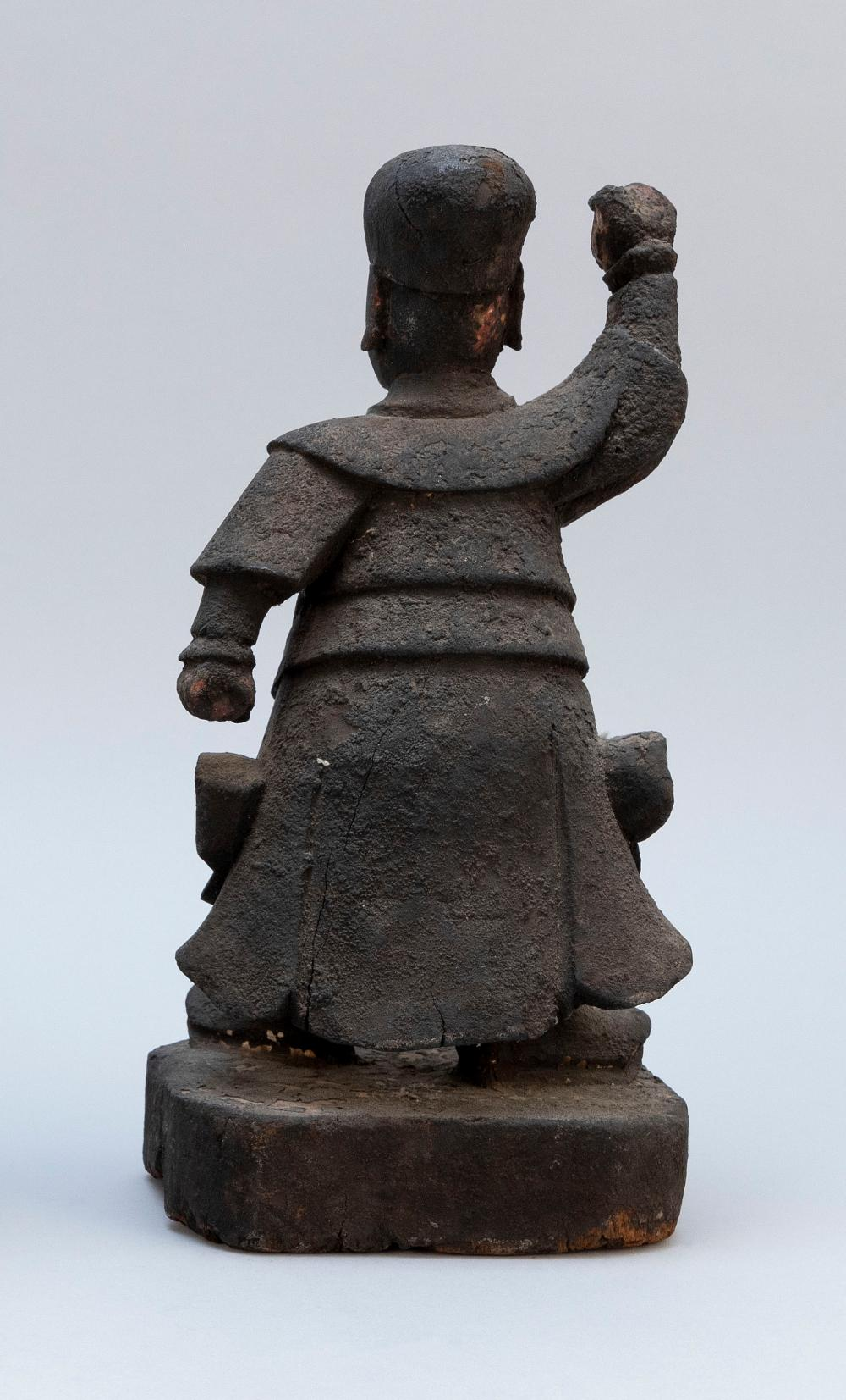 CHINESE CARVED WOOD GUANDI Standing on a wood base. Height 12