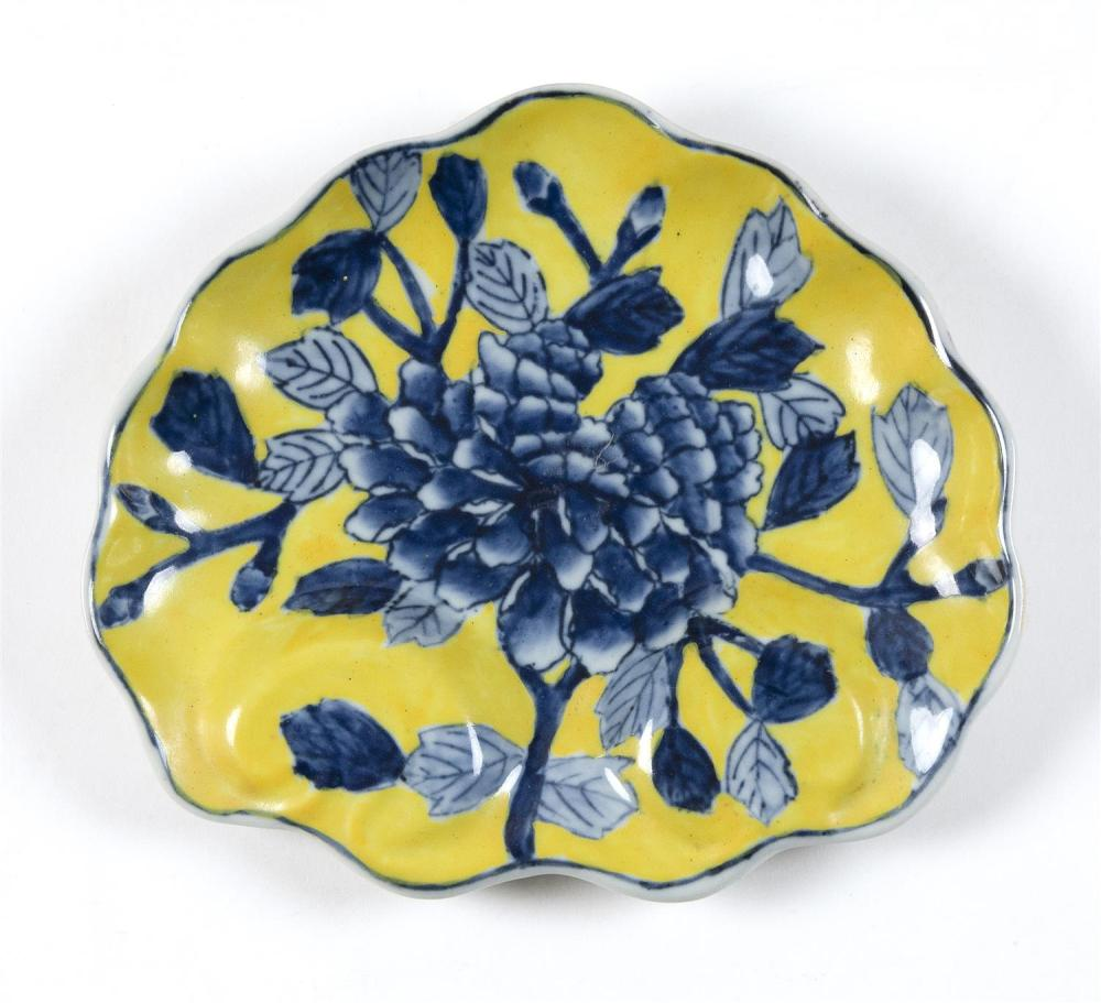"""CHINESE MING-STYLE IMPERIAL YELLOW PORCELAIN DISH In palmette shape, with blue floral decoration. Marked on base. Length 6.25""""."""