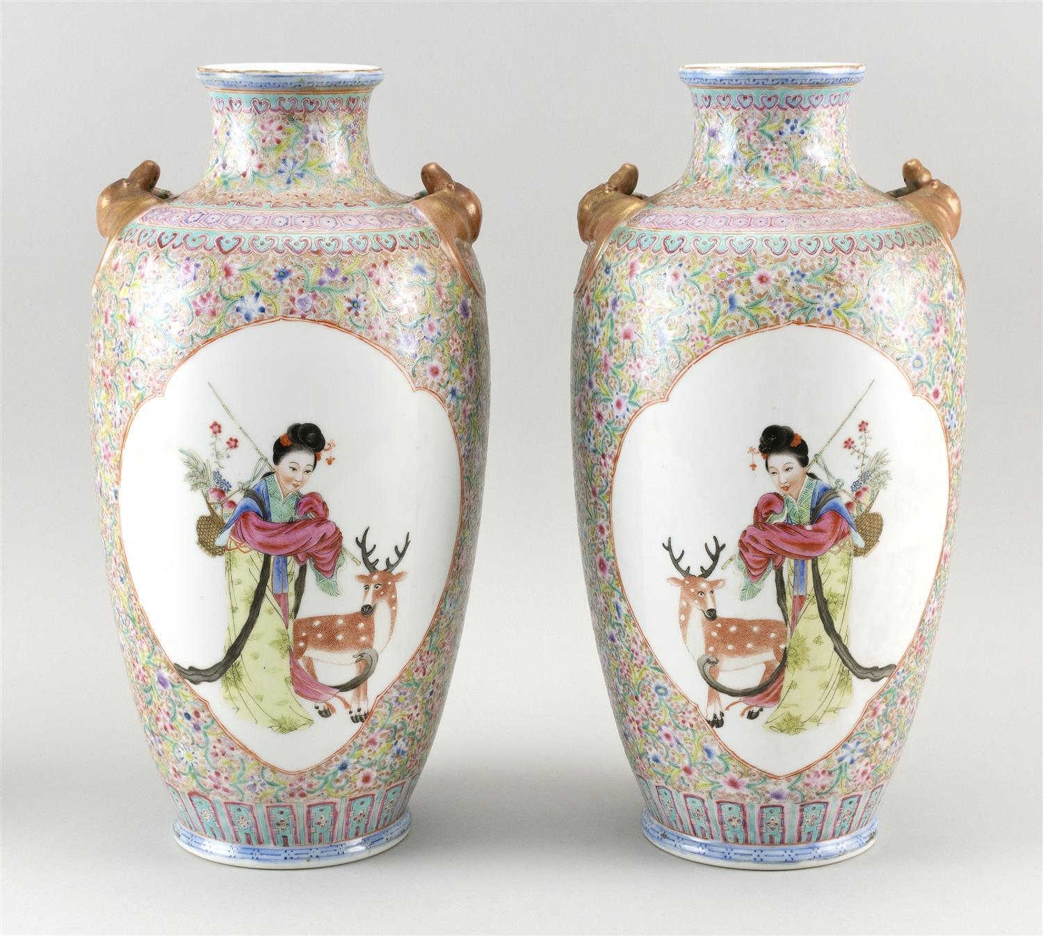 PAIR OF CHINESE FAMILLE ROSE PORCELAIN VASES In rouleau form, with gilt bat-form handles at shoulder and decoration of figural reser...