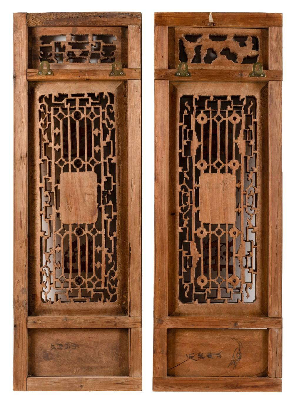 PAIR OF CHINESE CARVED WOOD PANELS Openwork-carved figural, floral and Greek fret design. Heights 36