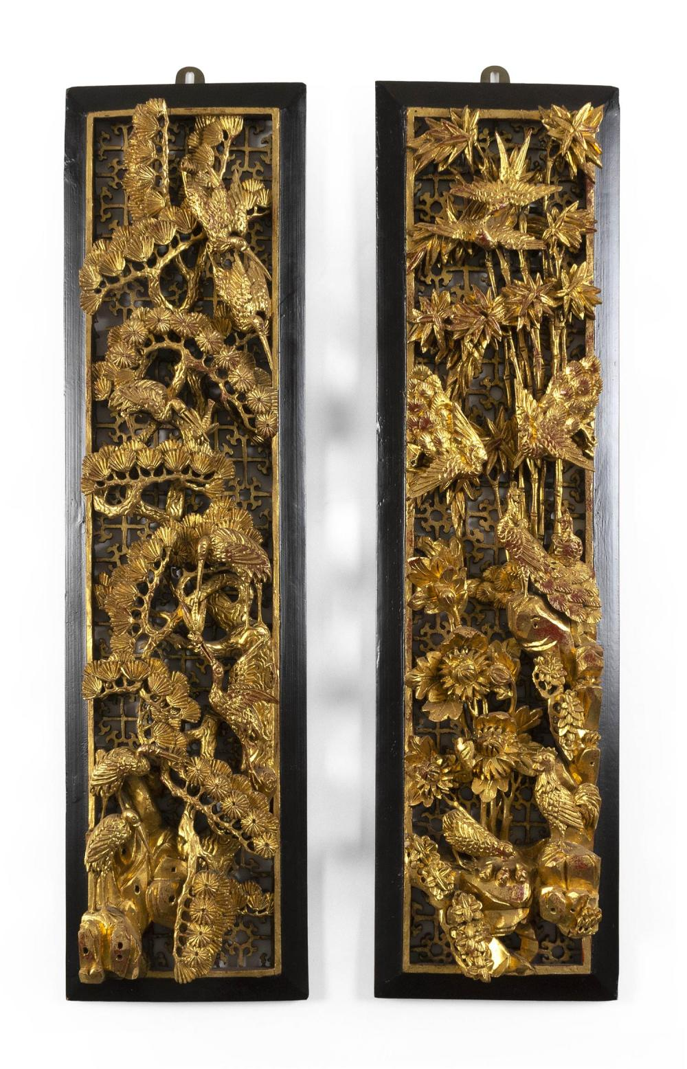 PAIR OF CHINESE CARVED GILTWOOD PANELS Raised decoration of various birds on bamboo, chrysanthemum, prunus, pine trees and rockery a...