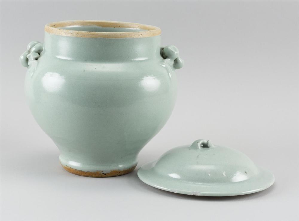 KOREAN CELADON PORCELAIN COVERED JAR Ovoid, with stem-like finial on cover and fruit-form handles on jar. Height 10
