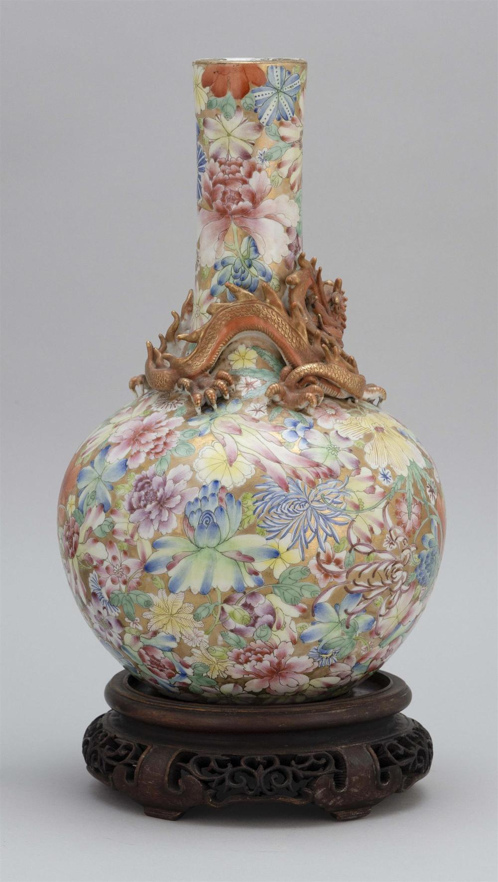 CHINESE PORCELAIN VASE Thousand Flower decoration. Applied dragon at shoulder. Drilled through seal mark on base. Height 13.75