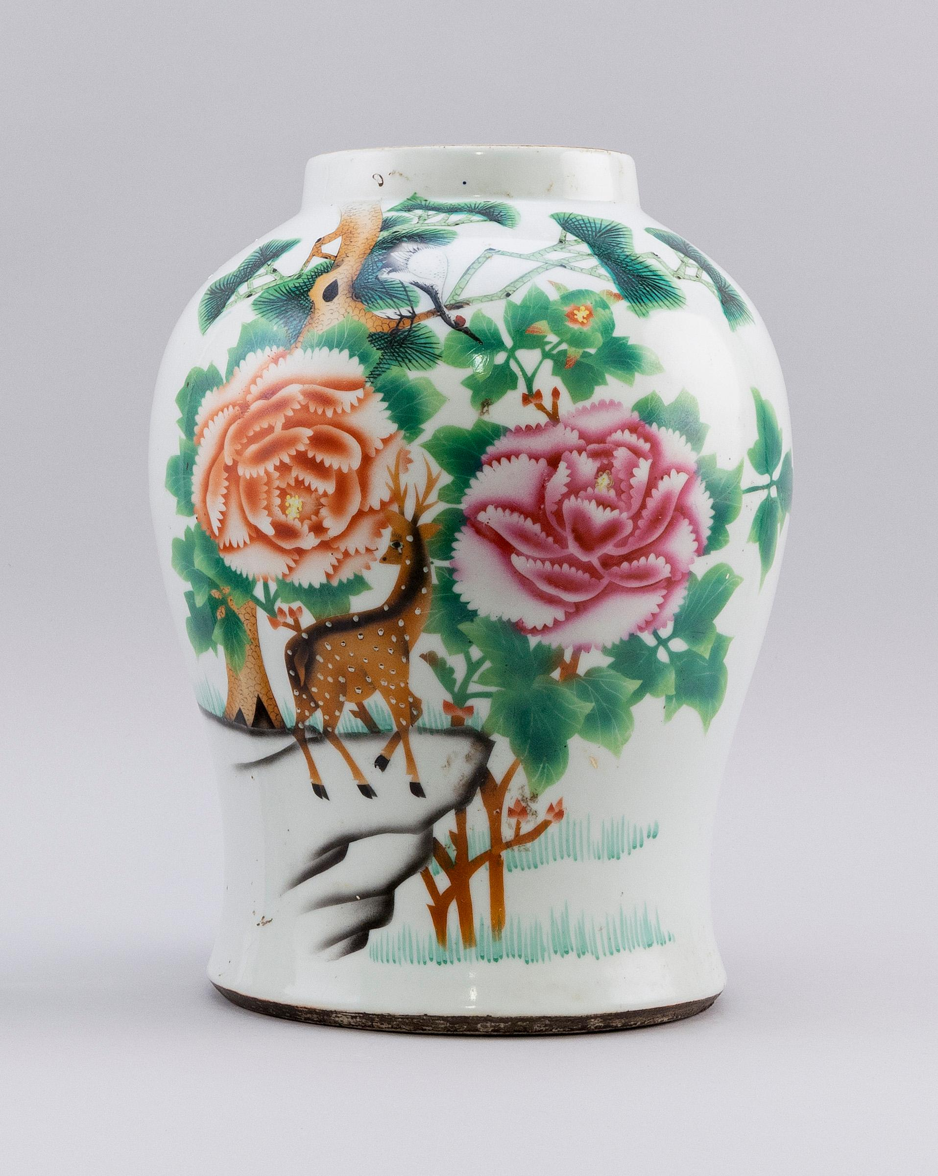 CHINESE FAMILLE ROSE PORCELAIN VASE In a squat baluster form, with decoration of spotted deer and crane in a landscape on obverse an...