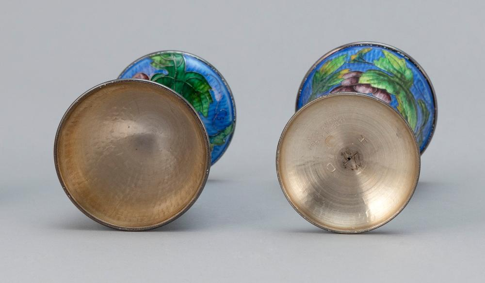 PAIR OF KOREAN CLOISONNÉ ENAMEL-OVER-SILVER STEMMED WINE CUPS Cups and bases with grape and vine decoration on a blue ground. Bases...