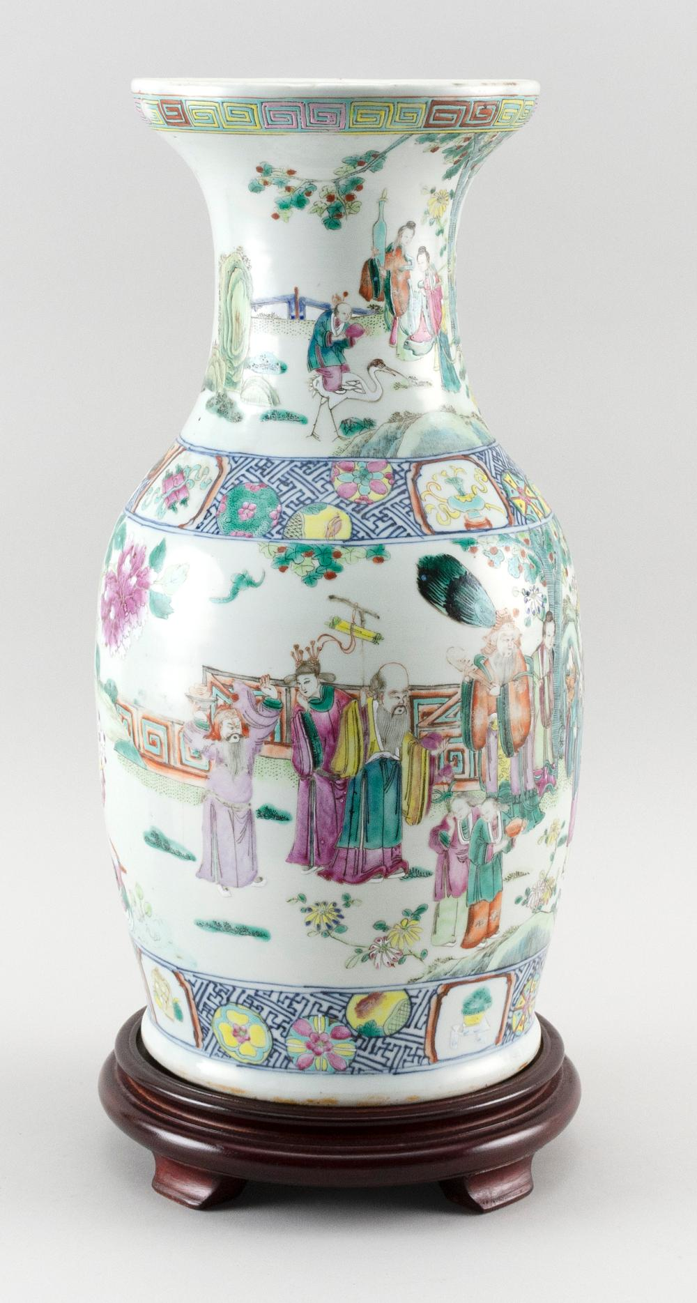 CHINESE PORCELAIN FAMILLE ROSE BALUSTER VASE Figural landscape decoration about the body and eight precious objects about the should...
