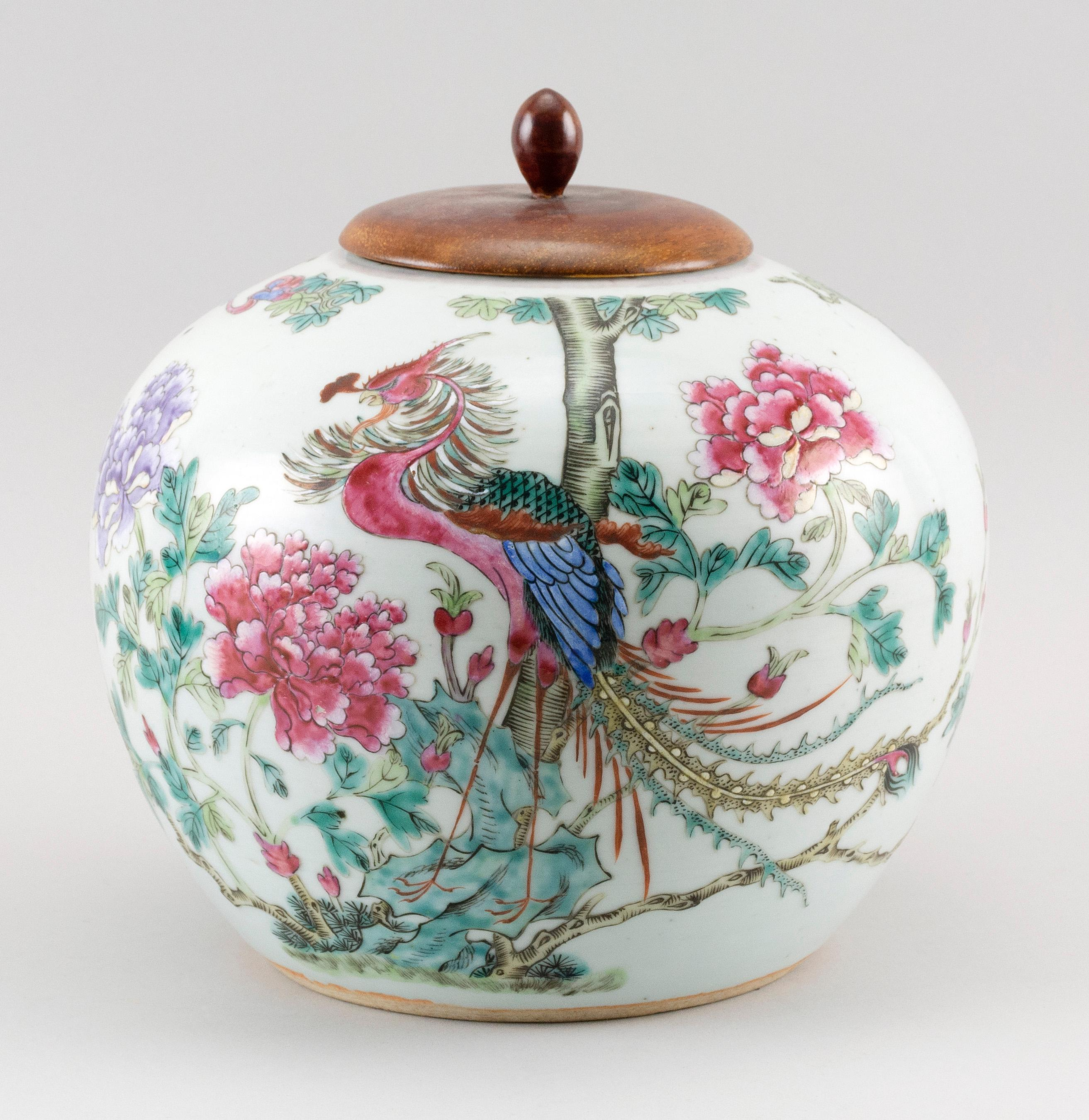 """CHINESE FAMILLE ROSE PORCELAIN GINGER JAR Decoration of a phoenix in a peony garden. Height 8"""". With rosewood cover and stand."""