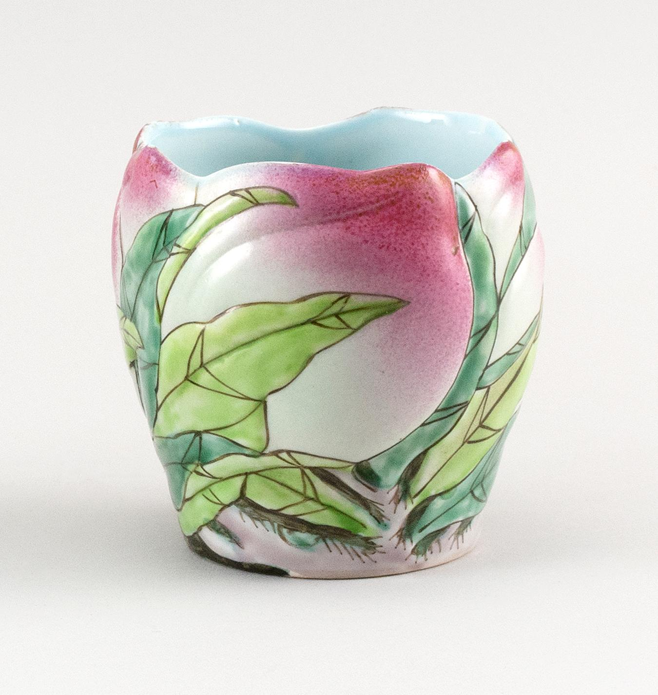 """CHINESE FAMILLE ROSE PORCELAIN VASE In molded peach form, with peach and leaf decoration. Height 4"""". Diameter 3.5""""."""