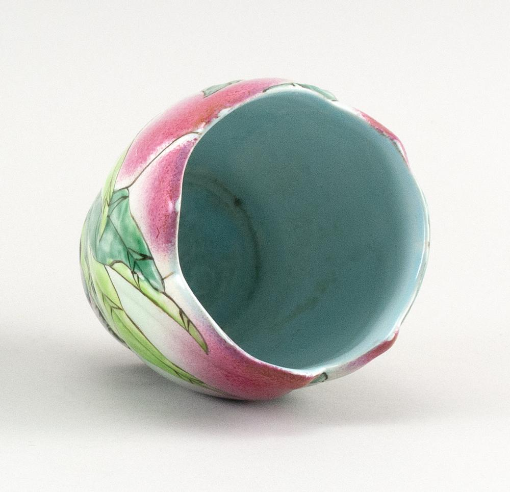 CHINESE FAMILLE ROSE PORCELAIN VASE In molded peach form, with peach and leaf decoration. Height 4