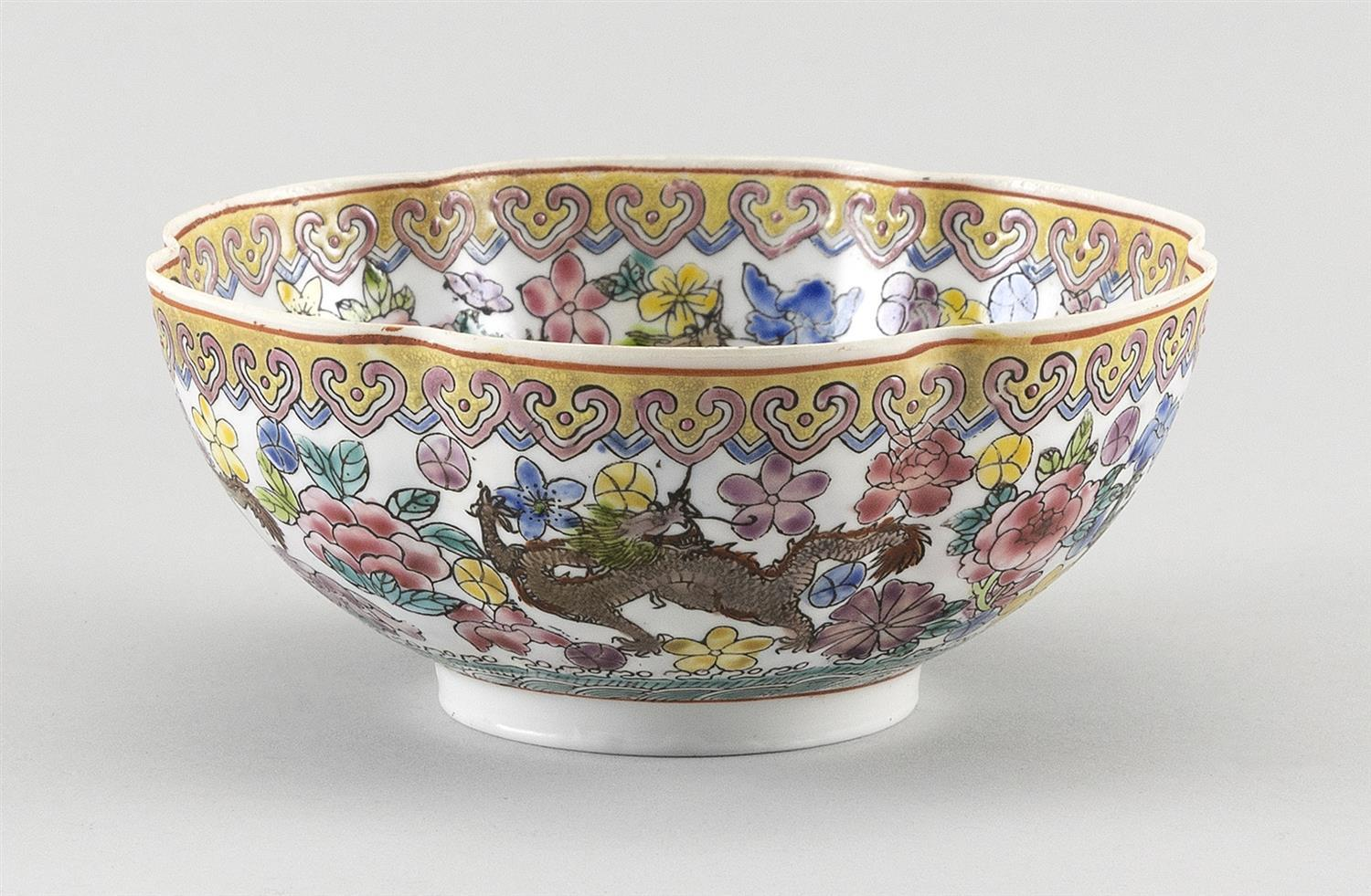 CHINESE FAMILLE ROSE EGGSHELL PORCELAIN BOWL Floriform, with decoration of five-clawed dragons and flowers on a white ground with la...