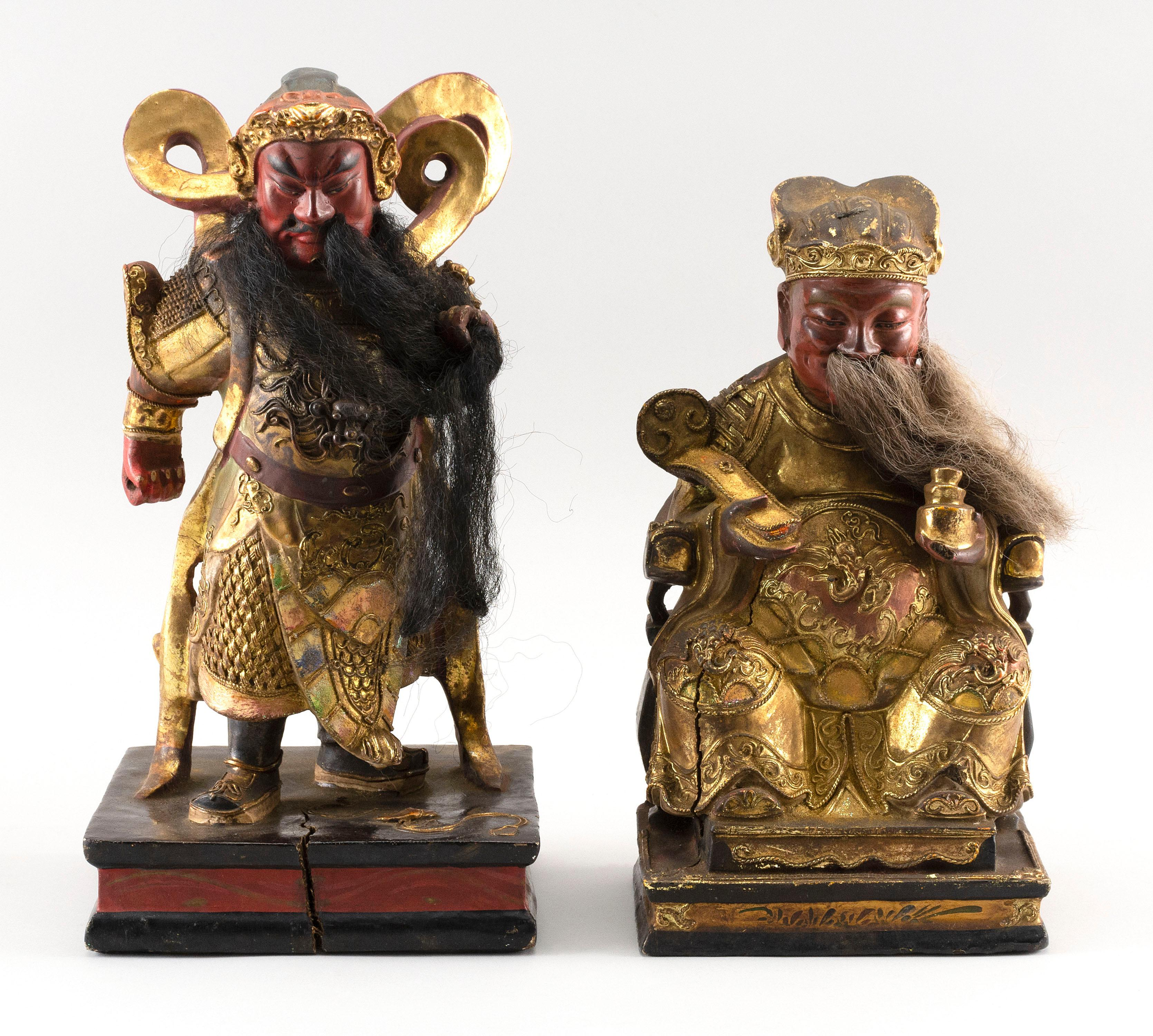 """TWO CHINESE GILT AND LACQUERED CARVED WOOD GUARD AND WARRIOR FIGURES Ornately carved. Both with horsehair details. Heights 10"""" and 1..."""